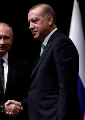 Turkish President Tayyip Erdogan shakes hands with Russian President Vladimir Putin after a news conference in Ankara, Turkey, December 11, 2017. REUTERS/Umit Bektas