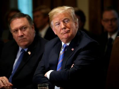 U.S. Secretary of State Mike Pompeo and President Donald Trump listen during a cabinet meeting at the White House in Washington, U.S., July 18, 2018. REUTERS/Leah Millis