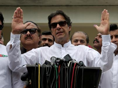 Cricket star-turned-politician Imran Khan, chairman of Pakistan Tehreek-e-Insaf (PTI), speaks after voting in the general election in Islamabad, Pakistan July 25, 2018. REUTERS/Athit Perawongmetha/File Photo