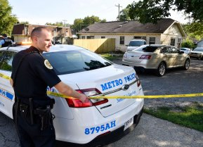 Police place crime scene tape Monday, Aug. 20,, 2018, around a home on Dr. DB Todd Jr. Blvd. in Nashville, Tenn., where Demontrey Logsdon was taken into custody for questioning in last week's shooting outside The Cobra bar