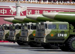 Military vehicles carrying DF-26 ballistic missiles travel past Tiananmen Gate during a military parade to commemorate the 70th anniversary of the end of World War II in Beijing Thursday Sept. 3, 2015.
