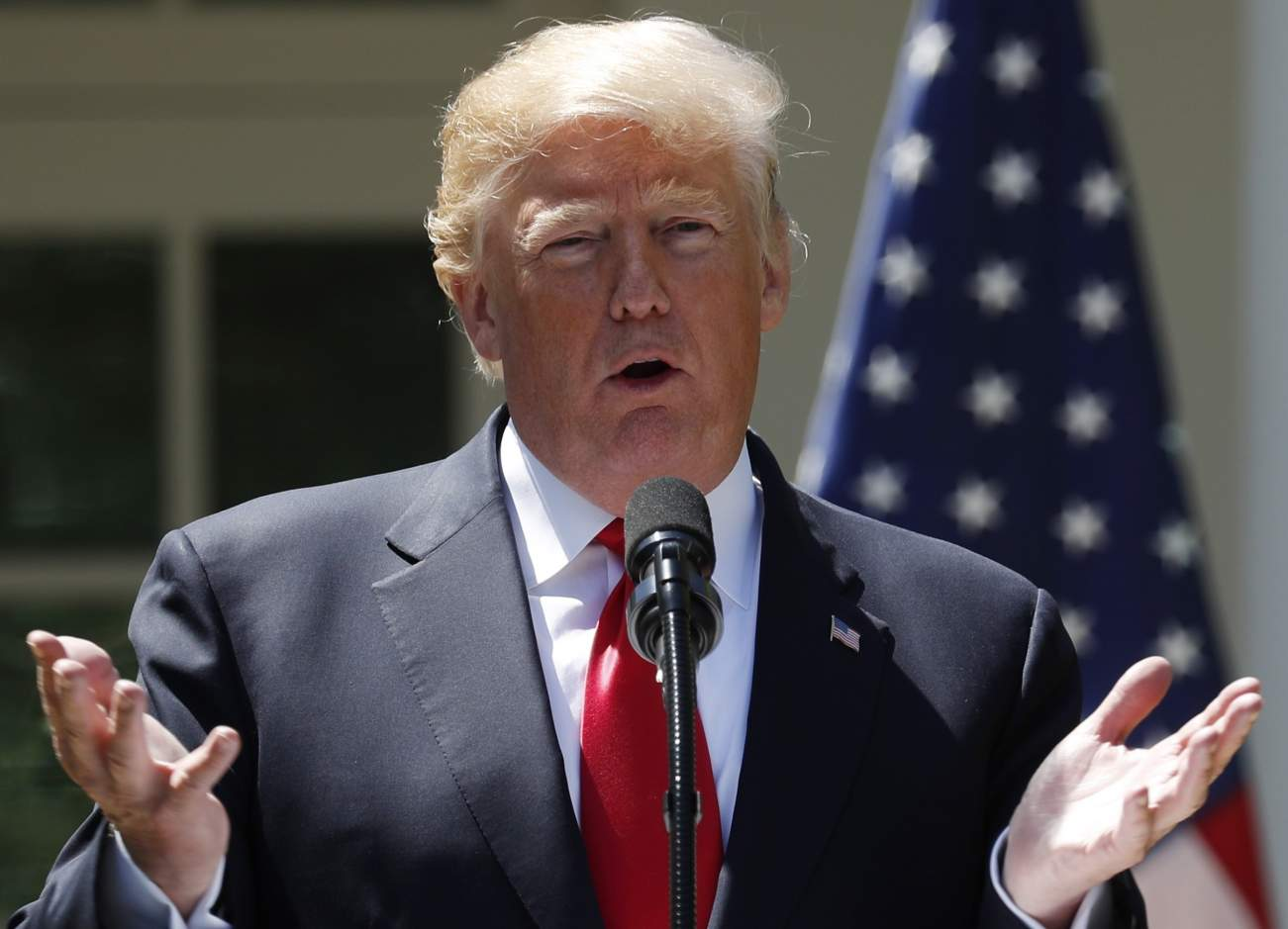 U.S. President Donald Trump addresses a joint news conference with Nigeria's President Muhammadu Buhari in the Rose Garden of the White House in Washington, U.S., April 30, 2018.