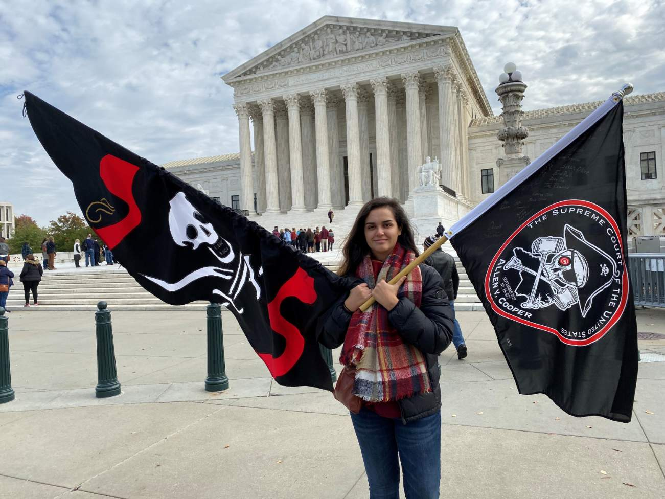 Christina Burnham holds pirate-themed flags in front of the Supreme Court in Washington November 5, 2019 in support of her uncle, Frederick Allen, a filmmaker whose appeal in a copyright lawsuit over the use of his footage of Blackbeard's shipwreck is bei