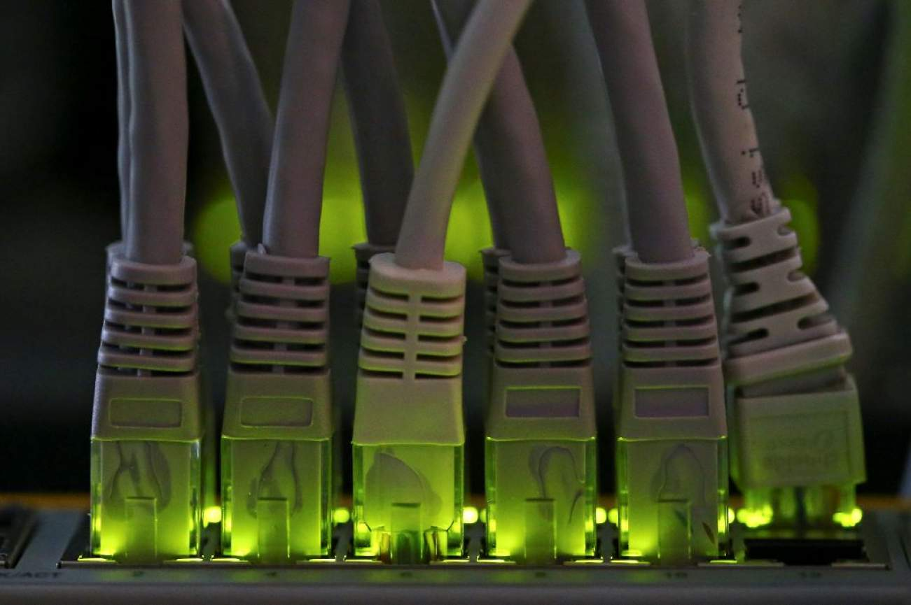 LAN network cables plugged into a Bitcoin mining computer server are pictured in Bitminer Factory in Florence, Italy, April 6, 2018. Picture taken April 6, 2018. REUTERS/Alessandro Bianchi