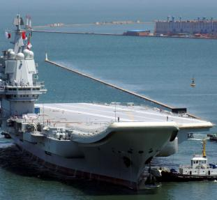 China's first domestically developed aircraft carrier is seen at a port in Dalian after completing its first sea trials, in Liaoning province, China May 18, 2018. Picture taken May 18, 2018. REUTERS/Stringer ATTENTION EDITORS - THIS IMAGE WAS PROVIDED BY