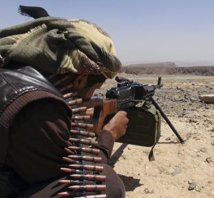 A Southern Movement militant takes aim with his machine gun as he takes part in the securing of the Jabal al-Ierr area against Shi'ite Houthi fighters, in Yemen's southern Lahej province March 7, 2015. Most of Yemen has been left without state services or