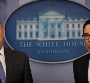U.S. National Economic Director Gary Cohn (L) and Treasury Secretary Steven Mnuchin react to questions while unveiling the Trump administration's tax reform proposal in the White House briefing room in Washington, U.S, April 26, 2017. REUTERS/Carlos Barri