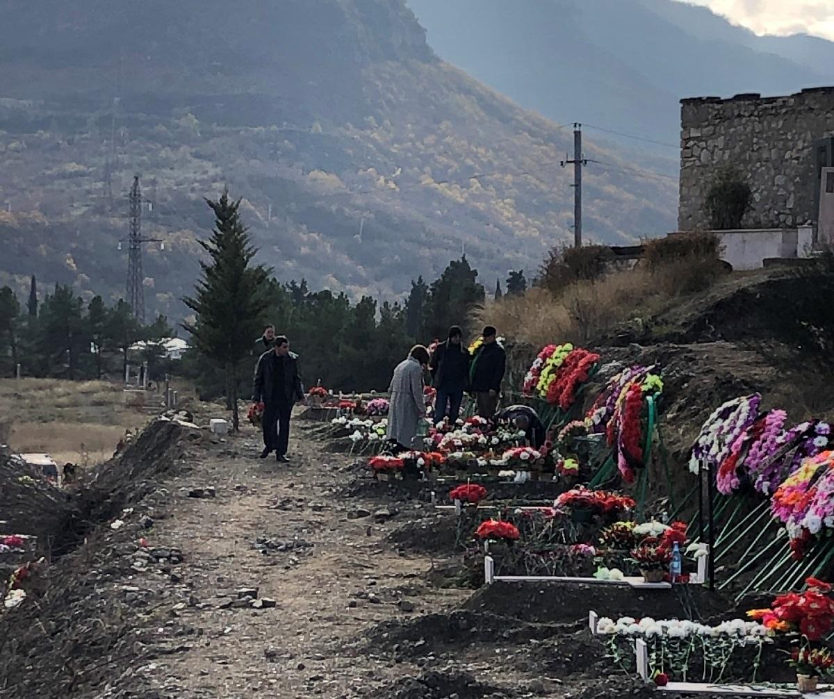 Fresh graves for war dead in Stepanakert.